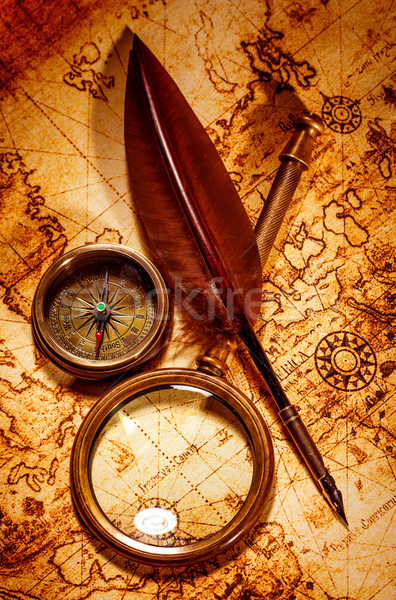 Vintage magnifying glass lies on an ancient world map Stock photo © cookelma