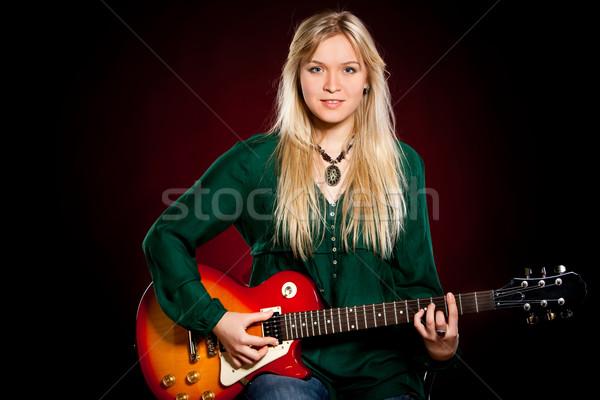 Kız gitar karanlık kırmızı kadın müzik Stok fotoğraf © cookelma