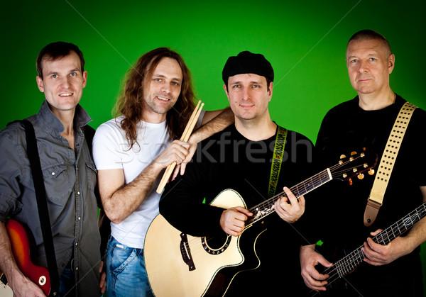 Musical grupo moda amigos homens jeans Foto stock © cookelma