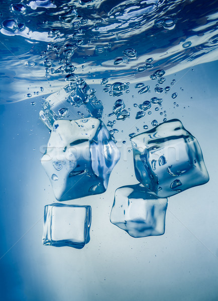 Ice cubes falling under water Stock photo © cookelma