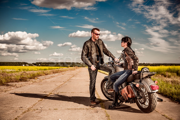 Stock photo: Bikers couple stands on the road