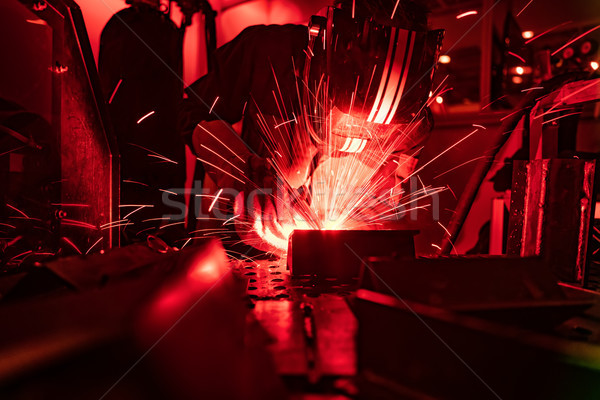 Welder in mask welding metal authentic shooting through red safe Stock photo © cookelma