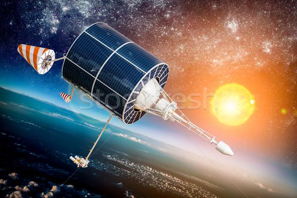 Przestrzeni satelitarnej planety Ziemi ziemi star słońce Zdjęcia stock © cookelma