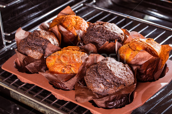 Muffins in the oven Stock photo © cookelma