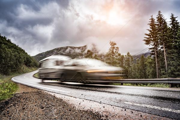 Caravan car trailer travels on the highway. Stock photo © cookelma