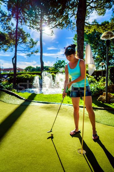 Mini golf kadın oynama yeşil ot gün batımı Stok fotoğraf © cookelma
