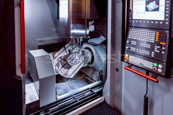 Metalworking CNC milling machine. Cutting metal modern processin Stock photo © cookelma