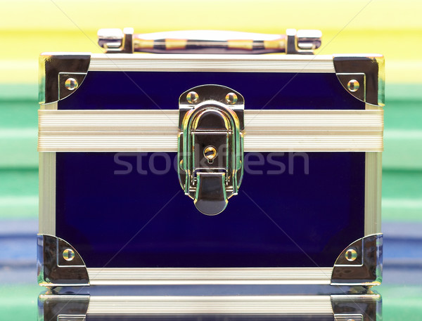 Dark blue steel small suitcase with the lock on a multi-coloure Stock photo © cookelma