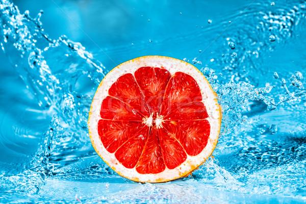 Friss grapefruit víz csobbanások gyümölcs szépség Stock fotó © cookelma