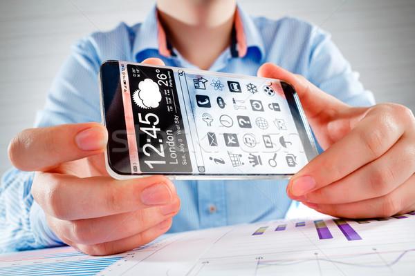 Smartphone transparant scherm menselijke handen display Stockfoto © cookelma