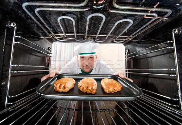 Chef cooking in the oven. Stock photo © cookelma