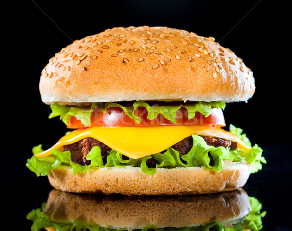 Tasty and appetizing hamburger on a dark Stock photo © cookelma