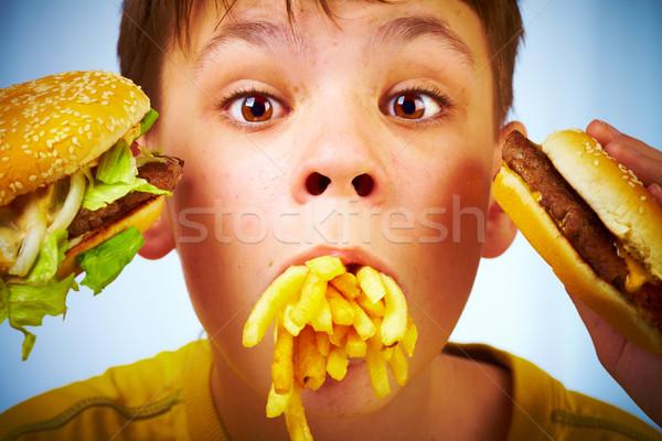 Kind fast food jongen maaltijd mond kid Stockfoto © cookelma