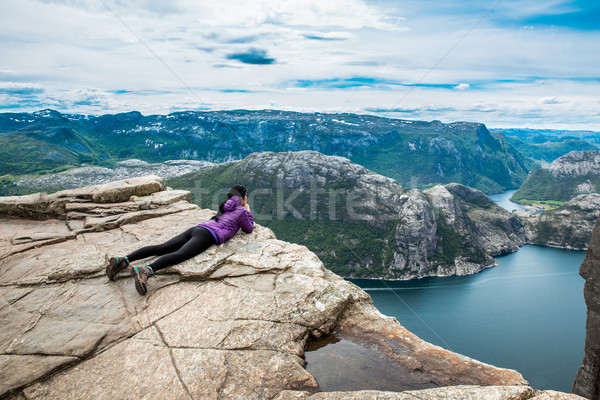 Prekestolen. Woman looking at the landscape from a height. Stock photo © cookelma