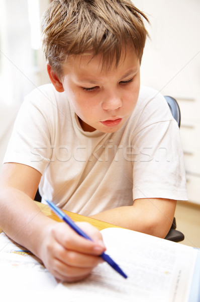 boy behind a desk Stock photo © cookelma