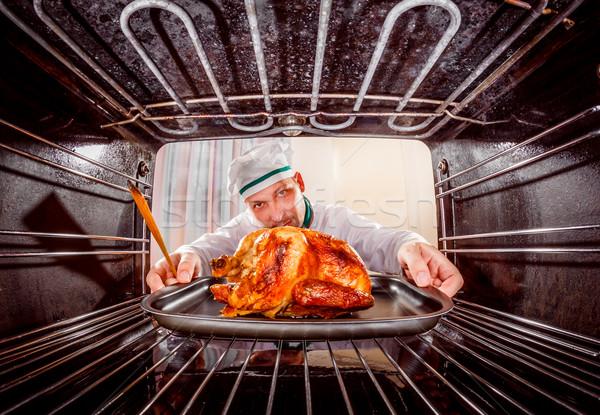 Cocina pollo horno chef pollo asado enfoque Foto stock © cookelma