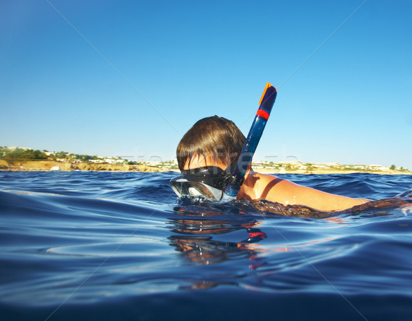 Stock photo: boy floats under water in the sea