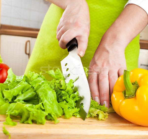Stock photo: Woman's hands cutting vegetables