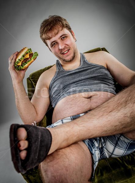 Foto d'archivio: Uomo · grasso · mangiare · hamburger · poltrona · stile