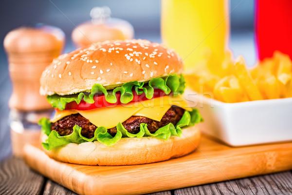 Hamburger smakelijk smakelijk hamburger cheeseburger voedsel Stockfoto © cookelma