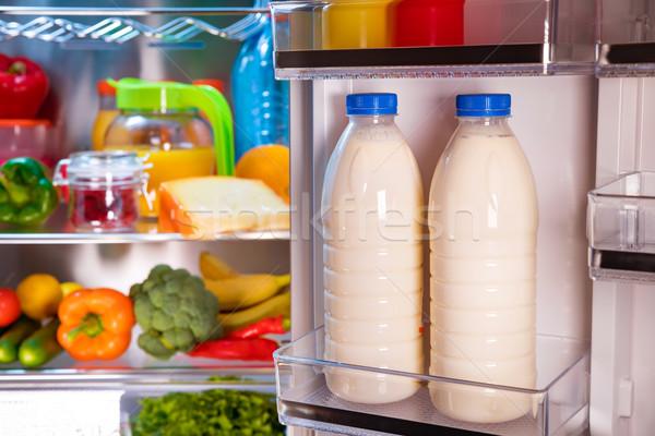 Açmak buzdolabı gıda odak şişeler süt Stok fotoğraf © cookelma