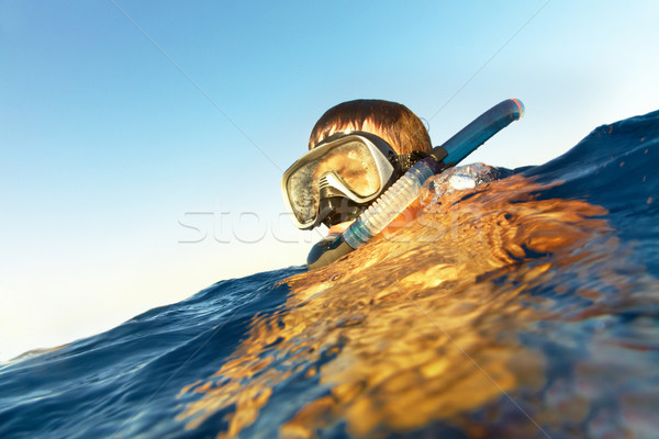 boy floats in the sea Stock photo © cookelma