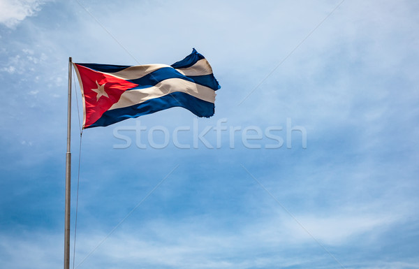 Cuban flag flying in the wind on a backdrop of blue sky. Stock photo © cookelma
