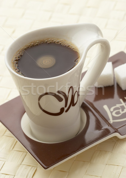 choco latte. A white cup of coffee on a support. Stock photo © cookelma
