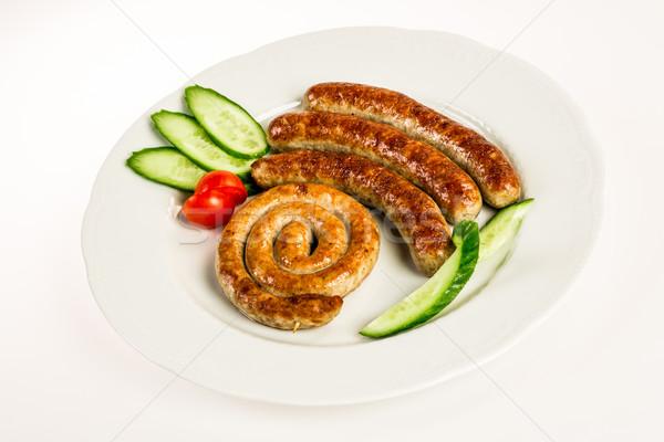 Gegrild vlees worstjes witte achtergrond vlees vet Stockfoto © cookelma