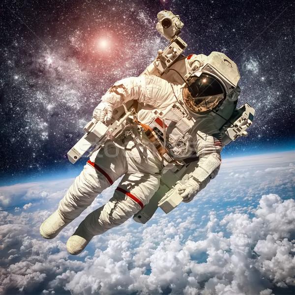 астронавт космическое пространство фон планете Земля Элементы изображение Сток-фото © cookelma