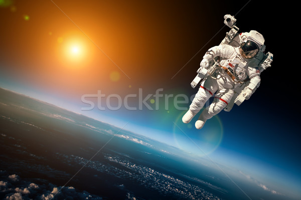 Foto stock: Astronauta · espacio · exterior · fondo · planeta · tierra · elementos · imagen