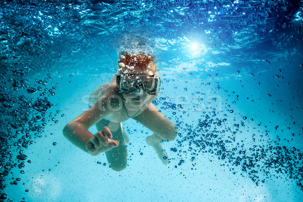 Teenager in the mask and snorkel swim underwater. Stock photo © cookelma