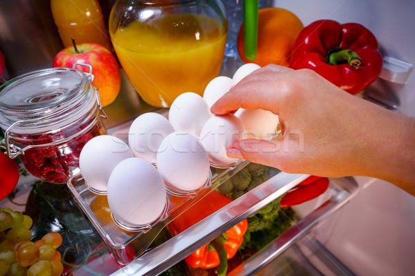 Tyúk tojások polc nyitva hűtőszekrény étel Stock fotó © cookelma