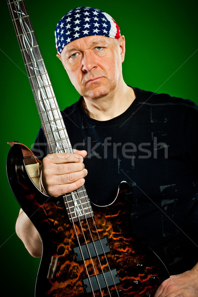 man with a guitar, bass player Stock photo © cookelma
