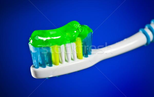 toothbrush on a dark blue background Stock photo © cookelma