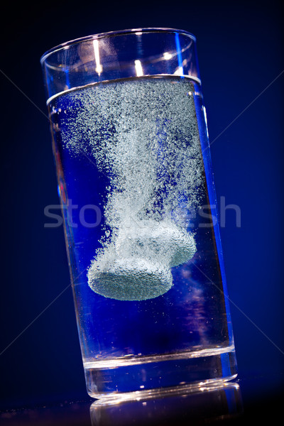 Tablet in a water glass Stock photo © cookelma