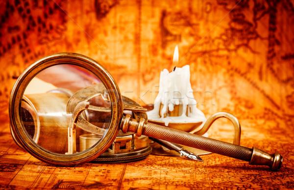 Vintage увеличительное стекло Ложь древних Мир карта натюрморт Сток-фото © cookelma