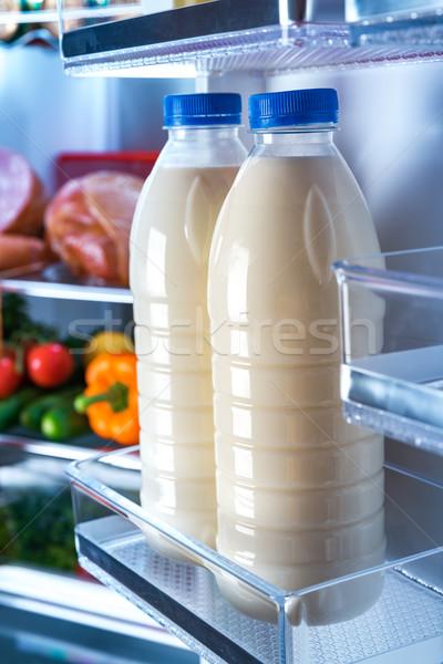 Bottles of milk in the fridge Stock photo © cookelma