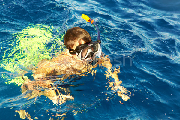 Stock photo: boy floats in the sea