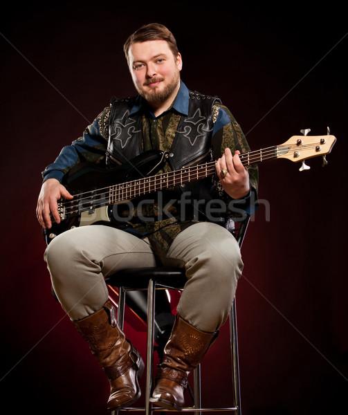 Stok fotoğraf: Adam · gitar · karanlık · kırmızı · erkekler · kaya