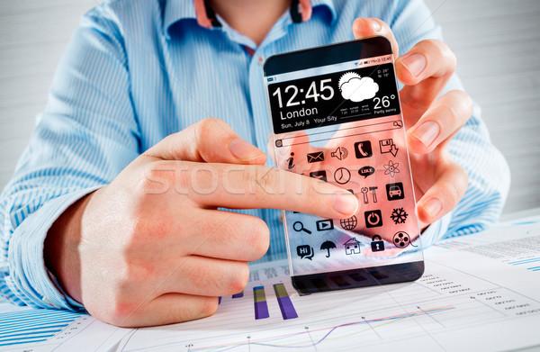 смартфон прозрачный экране человека рук отображения Сток-фото © cookelma