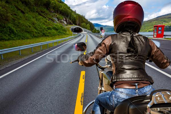 Biker girl First-person view, mountain serpentine. Stock photo © cookelma