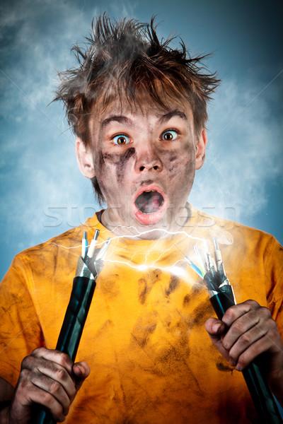 Elettrici shock scioccato ragazzo uomo capelli Foto d'archivio © cookelma