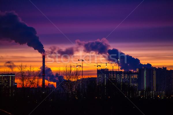 Moderno cidade noite pôr do sol fumar fora Foto stock © cookelma