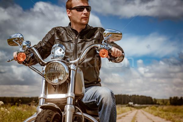 Motocicleta homem jaqueta de couro óculos de sol Foto stock © cookelma