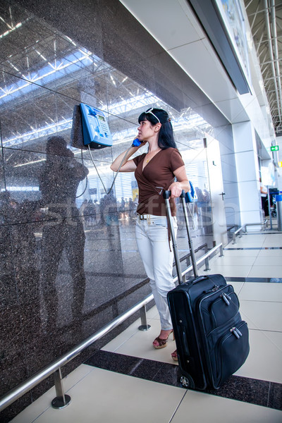 Woman calling on the phone at the airport Stock photo © cookelma