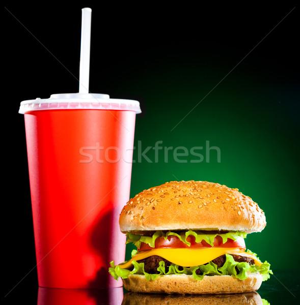Smaczny apetyczny hamburger zielone żywności liści Zdjęcia stock © cookelma