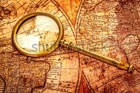 Vintage compass lies on the ancient map of the North Pole (also  Stock photo © cookelma