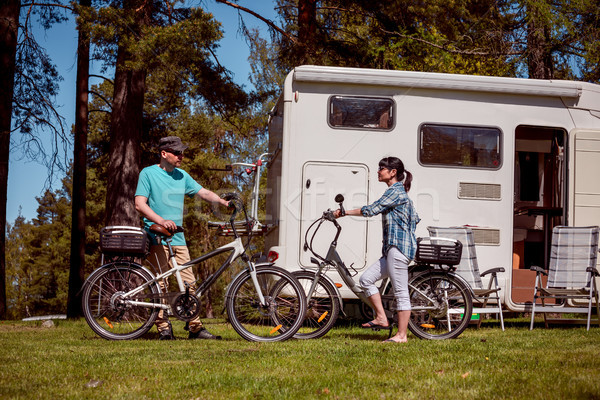 Woman with a man on electric bike resting at the campsite. Stock photo © cookelma