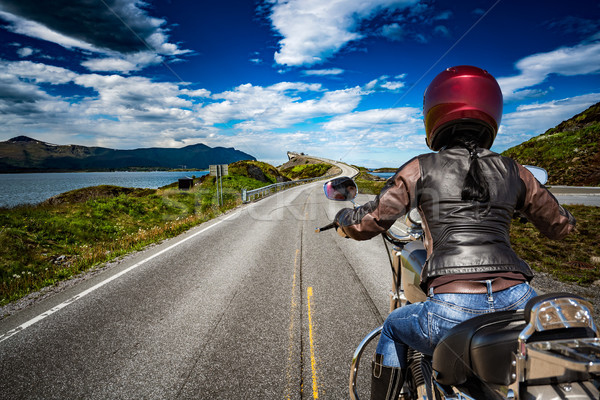 Biker girl rides a mountain road in Norway Atlantic Ocean Road.  Stock photo © cookelma